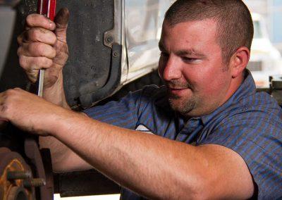 Derrick Repairing a Suspension Problem